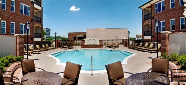 the pool deck at belle meade court condos